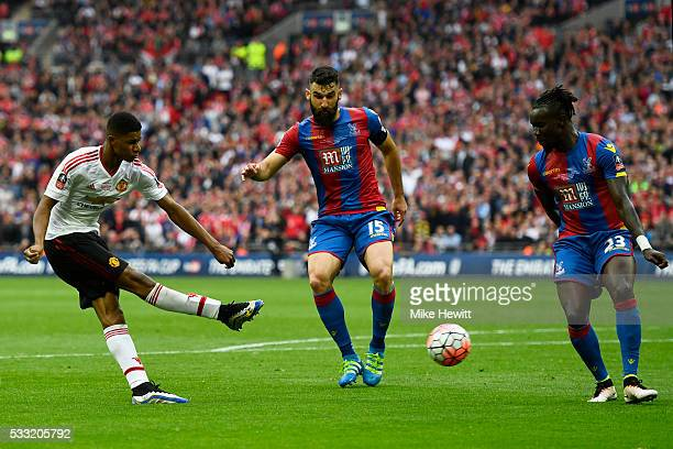 Marcus Rashford of Manchester United shoots past Mile Jedinak and Pape N'Diaye Souare of Crystal Palace during The Emirates FA Cup Final match...