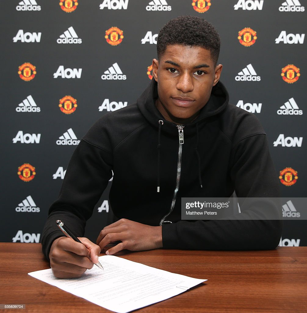 <a gi-track='captionPersonalityLinkClicked' href=/galleries/search?phrase=Marcus+Rashford&family=editorial&specificpeople=13847707 ng-click='$event.stopPropagation()'>Marcus Rashford</a> of Manchester United signs a new contract at Aon Training Complex on May 30, 2016 in Manchester, England.