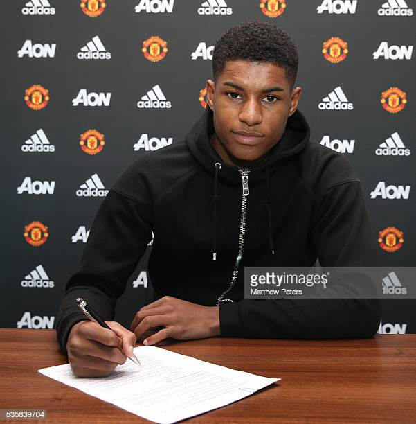 Marcus Rashford of Manchester United signs a new contract at Aon Training Complex on May 30 2016 in Manchester England