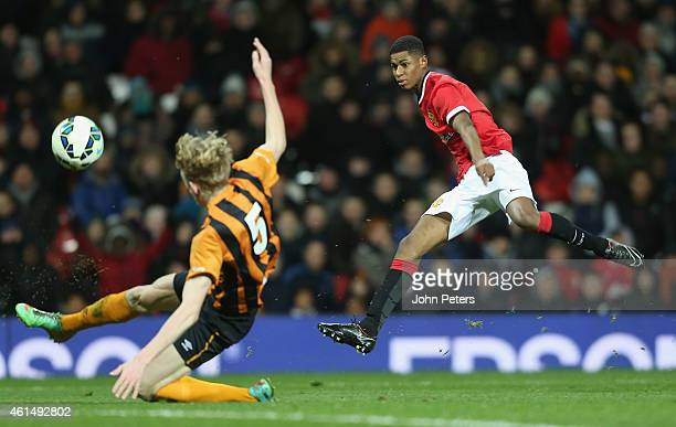 Marcus Rashford of Manchester United U18s in action with Harvey Rogers of Hull City U18s during the FA Youth Cup Fourth Round match between...