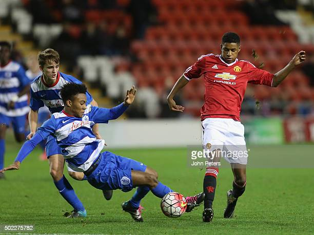 Marcus Rashford of Manchester United U18s in action with Leo Donnellan of Queens Park Rangers U18s during the FA Youth Cup third round match between...