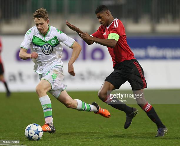 Marcus Rashford of Manchester United U19s in action with Paul Jaeckel of VfL Wolfsburg U19s during the UEFA Youth League match between VfL Wolfsburg...