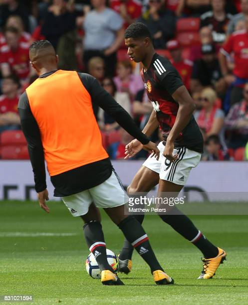 Marcus Rashford of Manchester United warms up ahead of the Premier League match between Manchester United and West Ham United at Old Trafford on...