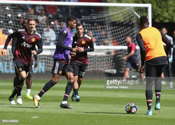 Marcus Rashford of Manchester United warms up ahead of the Premier League match between Swansea City and Manchester United at Liberty Stadium on...