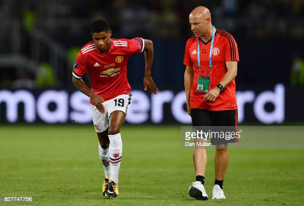 Marcus Rashford of Manchester United warms up at half time with Carlos Lalin Manchester United first team coach during the UEFA Super Cup final...