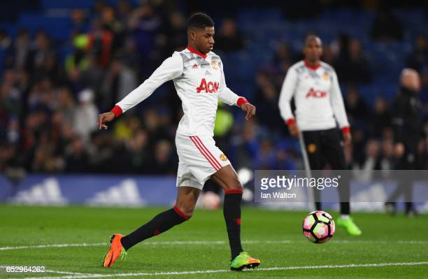 Marcus Rashford of Manchester United warms up prior to The Emirates FA Cup QuarterFinal match between Chelsea and Manchester United at Stamford...