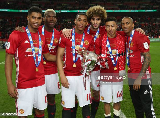 Marcus Rashford Paul Pogba Anthony Martial Marouane Fellaini Jesse Lingard and Ashley Young of Manchester United celebrate after the EFL Cup Final...