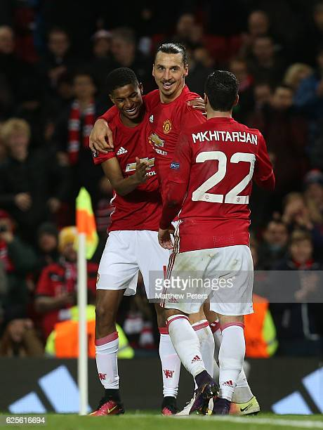 Marcus Rashford Zlatan Ibrahimovic and Henrikh Mkhitaryan of Manchester United celebrate Brad Jones of Feyenoord scoring an own goal during the UEFA...
