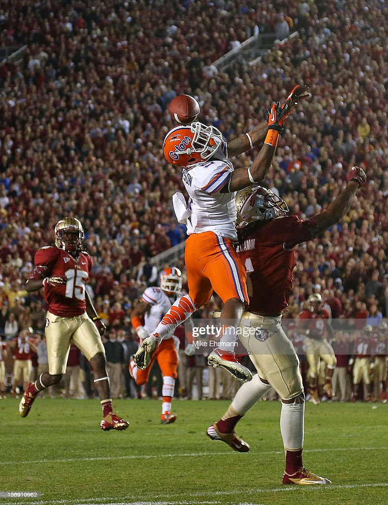 Marcus Roberson #5 of the Florida Gators goes up for an interception during a game against the Florida State Seminoles at Doak Campbell Stadium on November 24, 2012 in Tallahassee, Florida.