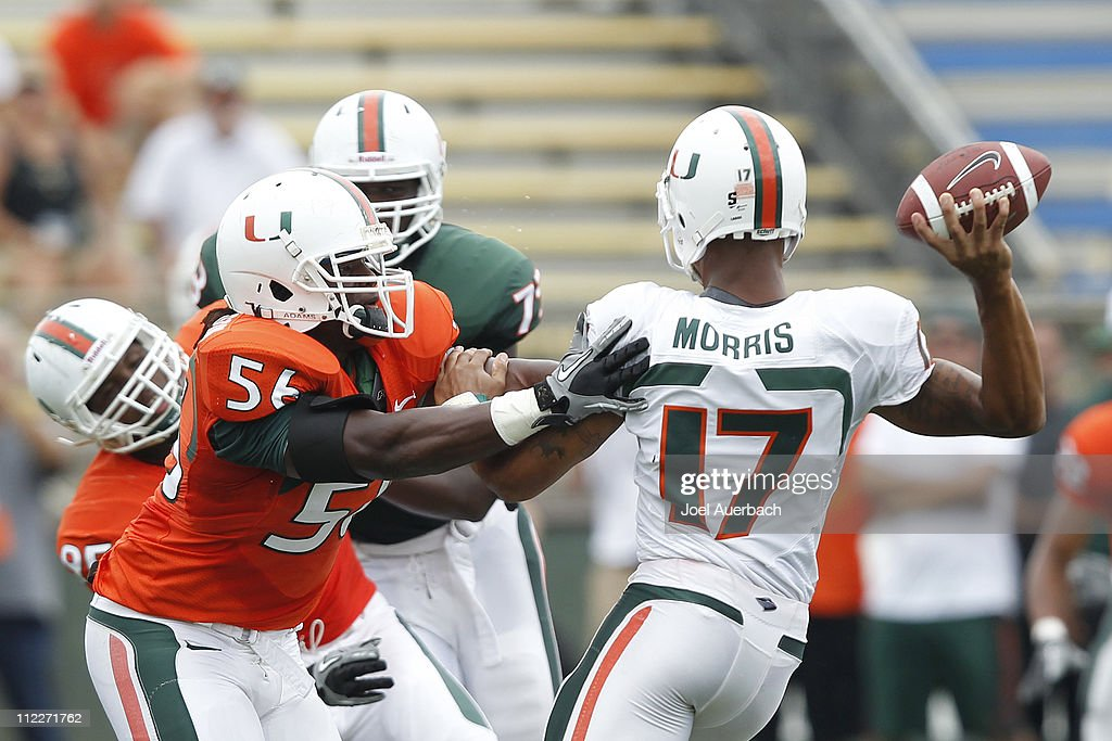 <a gi-track='captionPersonalityLinkClicked' href=/galleries/search?phrase=Marcus+Robinson&family=editorial&specificpeople=215475 ng-click='$event.stopPropagation()'>Marcus Robinson</a> #56 makes contact with Stephen Morris #17 of the Miami Hurricanes before he can get the pass away during the spring game on April 16, 2011 at Lockhart Stadium in Fort Lauderdale, Florida.