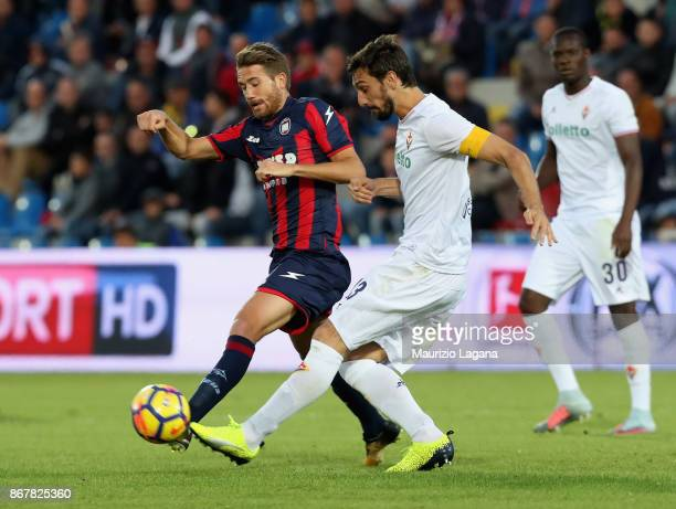 Marcus Rohden of Crotone competes for the ball with Davide Astori of Fiorentina during the Serie A match between FC Crotone and ACF Fiorentina at...