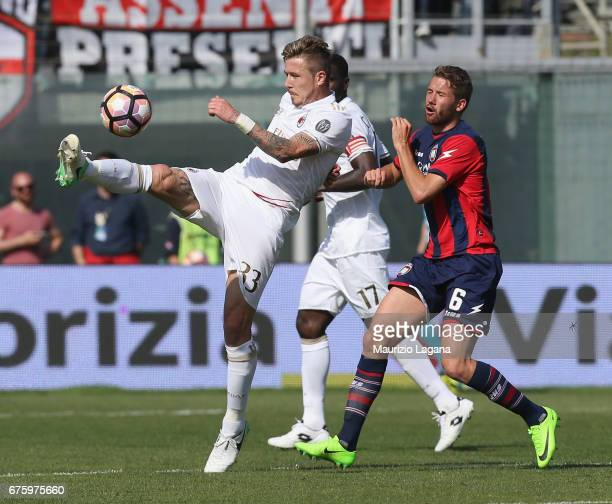 Marcus Rohden of Crotone competes for the ball with Juraj Kucka of Milan during the Serie A match between FC Crotone and AC Milan at Stadio Comunale...