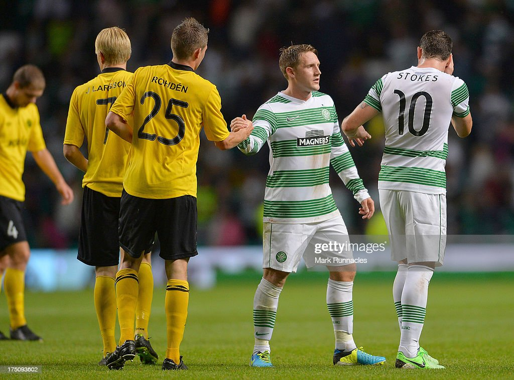 Marcus Rohden of Elfsborg shakes hands with Kris Commons of Celtic at the end of the UEFA Champions League Third Qualifying Round First Leg match between Celtic and Elfsborg at Celtic Park Stadium on July 31, 2013 in Glasgow, Scotland.
