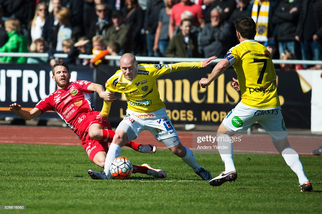 Marcus Rohden of IF Elfsborg, Christoffer Carlsson of Falkenberg and David Svensson of Falkenberg competes for the ball during the Allsvenskan match between Falkenbergs FF and IF Elfsborg at Falkenbergs IP on May 1, 2016 in Falkenberg, Sweden.