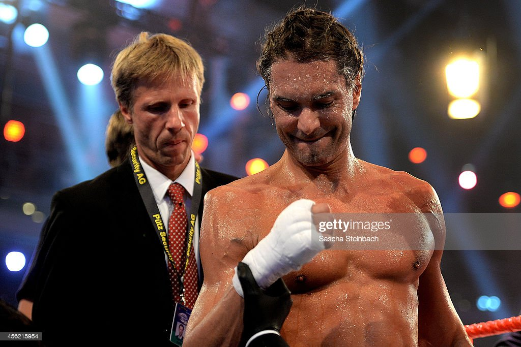 Marcus Schenkenberg leaves the ring after picking up an injury during the 'Das Grosse Prosieben Promiboxen' tv show at Castello on September 27 2014...