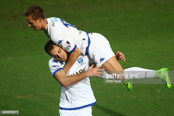 Marcus Schroen of South Melbourne jumps on Milos Lujic after he scores during the FFA Cup Quarter Final match between Gold Coast City FC and South...