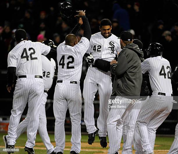 Marcus Semien of the Chicago White Sox celebrates with his teammates after driving in the game winning run during the ninth inning against the Boston...