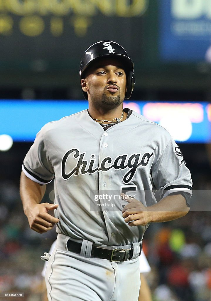 Marcus Semien #5 of the Chicago White Sox scores on the single to right field by Paul Konerko #14 in the eighth inning of the game against the Detroit Tigers at Comerica Park on September 21, 2013 in Detroit, Michigan.