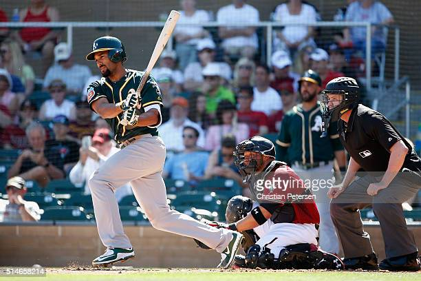Marcus Semien of the Oakland Athletics bats against the Arizona Diamondbacks during the spring training game at Salt River Fields at Talking Stick on...