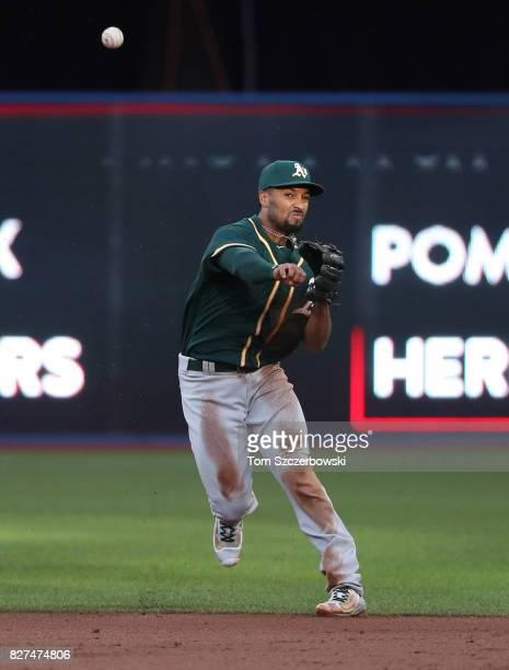 Marcus Semien of the Oakland Athletics cannot throw out Ezequiel Carrera of the Toronto Blue Jays who hits an infield single in the second inning...