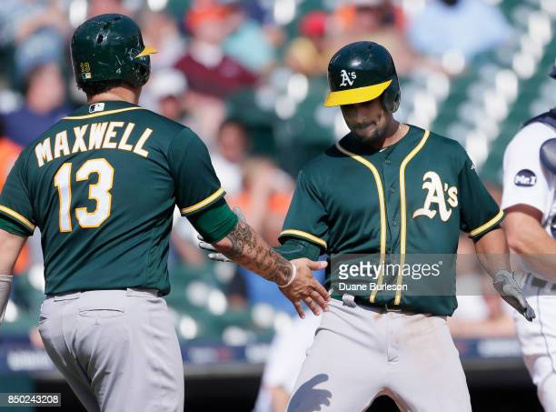Marcus Semien of the Oakland Athletics celebrates with Bruce Maxwell of the Oakland Athletics after hitting a tworun home run against the Detroit...