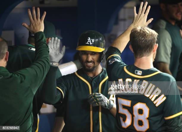 Marcus Semien of the Oakland Athletics is congratulated by Paul Blackburn after hitting a tworun home run in the fifth inning during MLB game action...