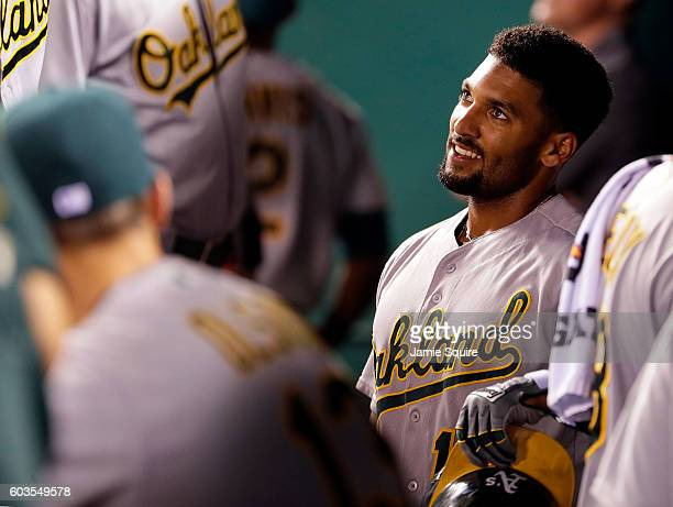 Marcus Semien of the Oakland Athletics is congratulated by teammates in the dugout after hitting a threerun home run during the 6th inning of the...