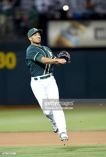 Marcus Semien of the Oakland Athletics makes an off balance throw and throws the ball away for an error against the Boston Red Sox in the top of the...