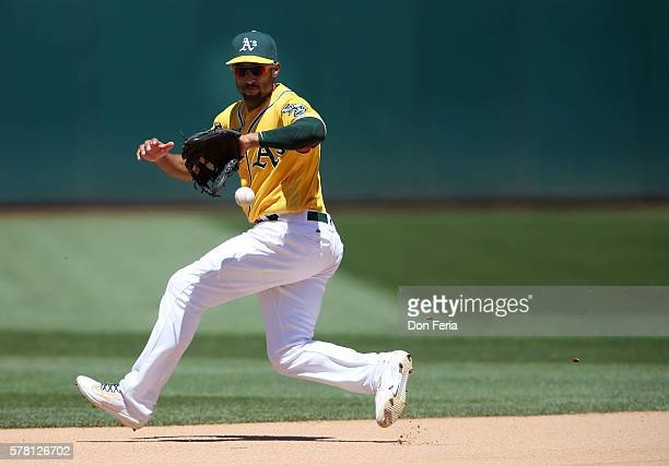 Marcus Semien of the Oakland Athletics makes the stop in the top of the seventh inning against the Houston Astros at the OaklandAlameda Coliseum on...
