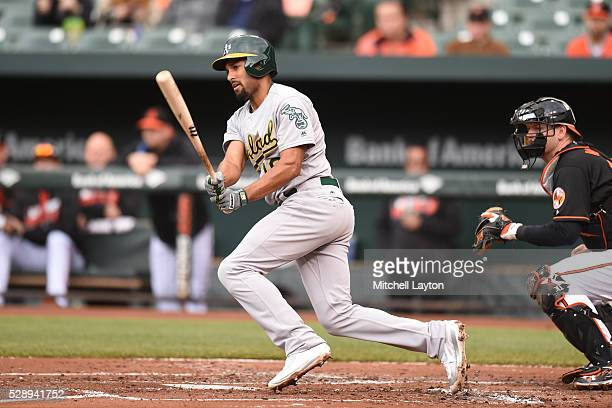 Marcus Semien of the Oakland Athletics singles in Coco Crisp in the second inning during game one of double header baseball game against the...