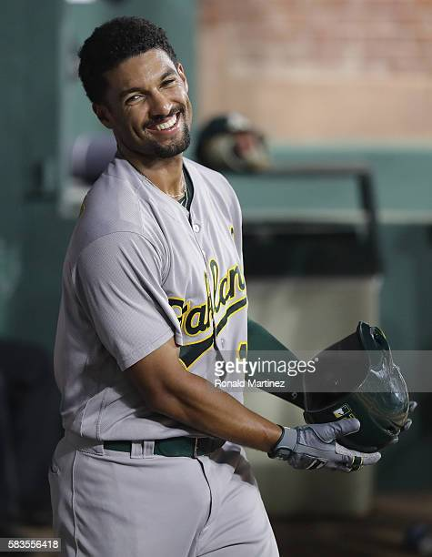 Marcus Semien of the Oakland Athletics smiles after hitting a homerun against the Texas Rangers in the fifth inning at Globe Life Park in Arlington...