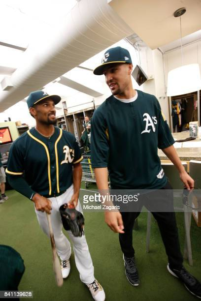 Marcus Semien of the Oakland Athletics talks with Klay Thompson of the Golden State Warriors in the clubhouse prior t the game against the San...