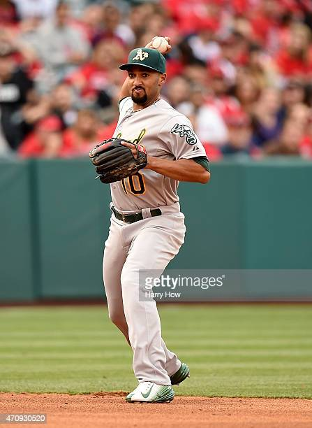 Marcus Semien of the Oakland Athletics throws out Albert Pujols of the Los Angeles Angels during the sixth inning at Angel Stadium of Anaheim on...