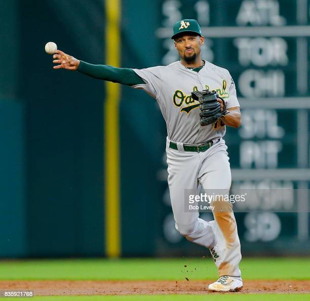 Marcus Semien of the Oakland Athletics throws out Jose Altuve of the Houston Astros in the third inning at Minute Maid Park on August 20 2017 in...