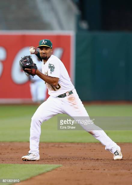 Marcus Semien of the Oakland Athletics throws the ball to first base against the Tampa Bay Rays at Oakland Alameda Coliseum on July 18 2017 in...