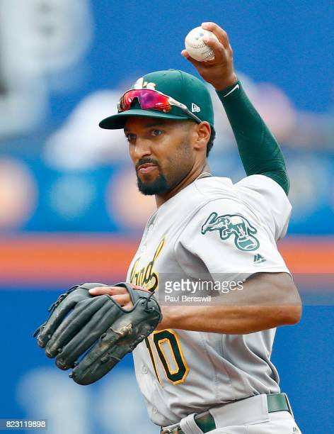 Marcus Semien of the Oakland Athletics throws to first base during an MLB baseball game against the New York Mets on July 23 2017 at CitiField in the...