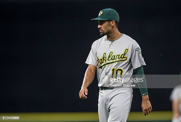 Marcus Semien of the Oakland Athletics walks across the field before a game against the Seattle Mariners at Safeco Field on September 30 2016 in...