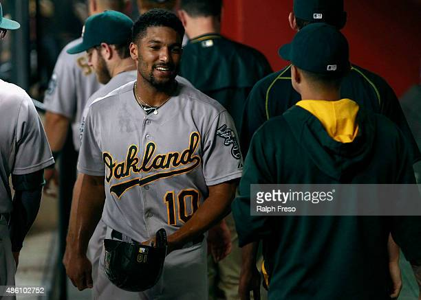 Marcus Semien of the Oakland Athletics walks through the dugout after scoring against the Arizona Diamondbacks on an RBI single by Billy Burns of the...
