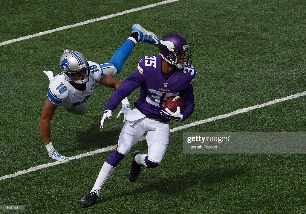 Marcus Sherels of the Minnesota Vikings avoids a tackle by Corey Fuller of the Detroit Lions during the first quarter of the game on September 20...