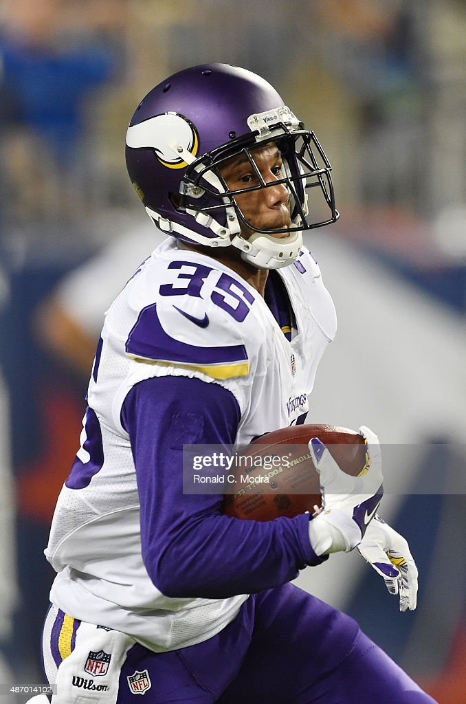Marcus Sherels of the Minnesota Vikings carries the ball during a NFL preseason game against the Tennessee Titans at Nissan Stadium on September 3...