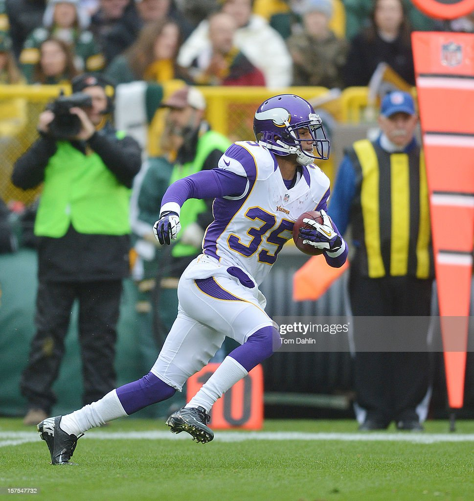 Marcus Sherels #35 of the Minnesota Vikings carries the ball during an NFL game against the Green Bay Packers at Lambeau Field on December 2, 2012 in Green Bay, Wisconsin.