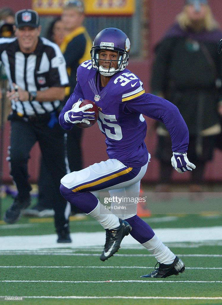 Marcus Sherels of the Minnesota Vikings carries the ball during an NFL game against the Atlanta Falcons at TCF Bank Stadium on September 28 2014 in...