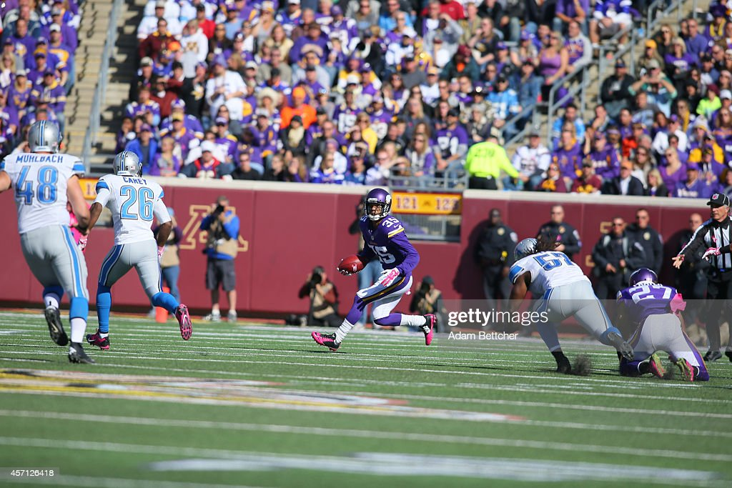 Marcus Sherels of the Minnesota Vikings carries the ball for a gain against the Detroit Lions during the fourth quarter on October 12 2014 at TCF...