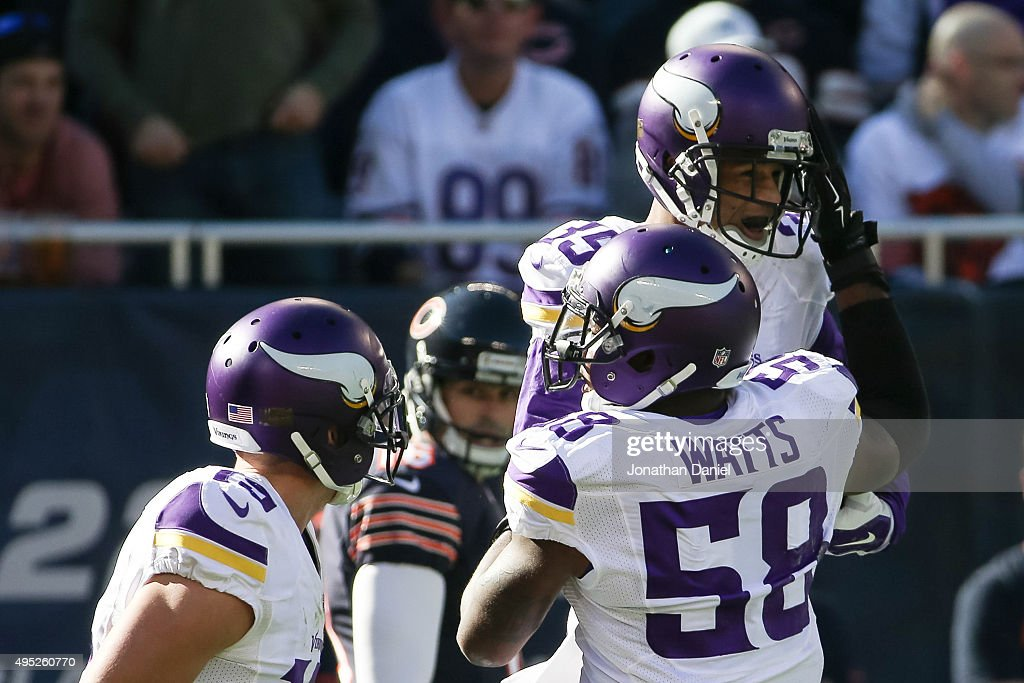 Marcus Sherels of the Minnesota Vikings celebrates with Brandon Watts after scoring a touchdown on a 65 yard punt return against the Chicago Bears in...