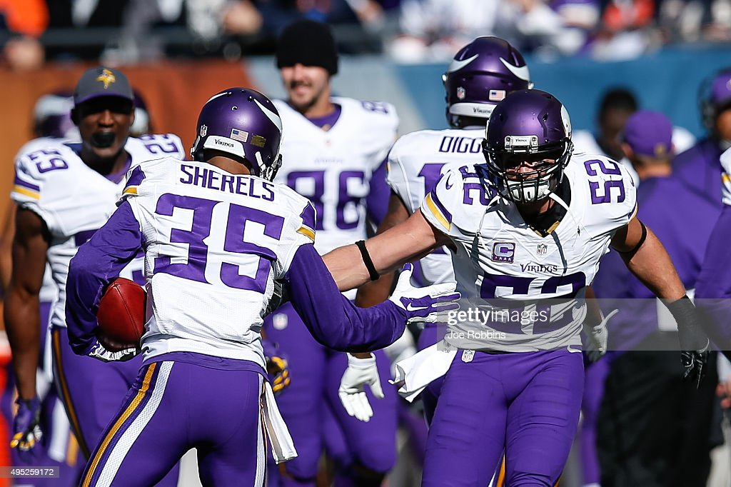 Marcus Sherels of the Minnesota Vikings celebrates with Chad Greenway after scoring a touchdown on a 65 yard punt return against the Chicago Bears in...