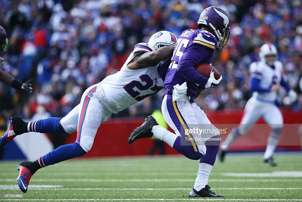 Marcus Sherels of the Minnesota Vikings is brought down by Duke Williams of the Buffalo Bills during the second half at Ralph Wilson Stadium on...