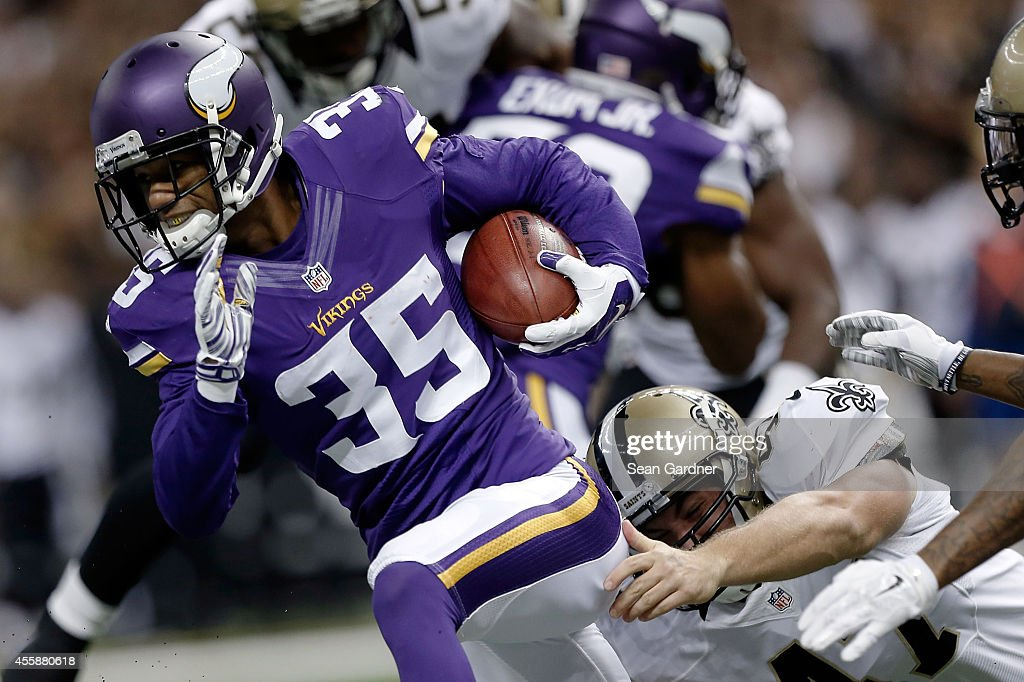 Marcus Sherels of the Minnesota Vikings is pursued by Justin Drescher of the New Orleans Saints during a game at the MercedesBenz Superdome on...