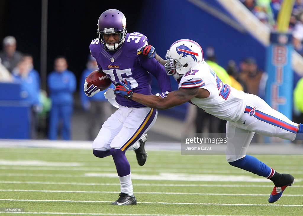 Marcus Sherels of the Minnesota Vikings is tackled by Duke Williams of the Buffalo Bills during the first half at Ralph Wilson Stadium on October 19...