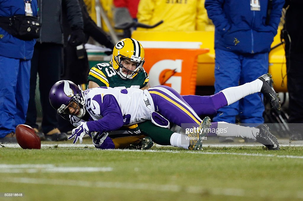 Marcus Sherels of the Minnesota Vikings muffs the catch on a kickoff return during the second quarter against the Green Bay Packers at Lambeau Field...