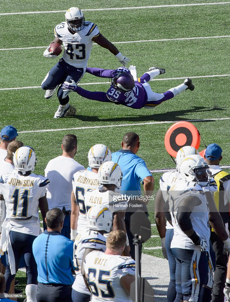 Marcus Sherels of the Minnesota Vikings pushes Branden Oliver of the San Diego Chargers out of bounds on a punt return during the fourth quarter of...